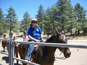 Me riding Charlie, a very tall horse.